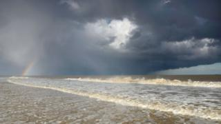 Hailstorm and rainbow over the seas of Covehithe