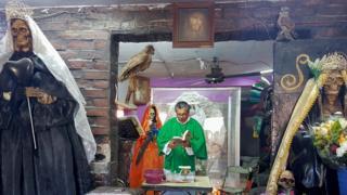 Daniel Santana's Sunday holds a service at a Santa Muerte temple.