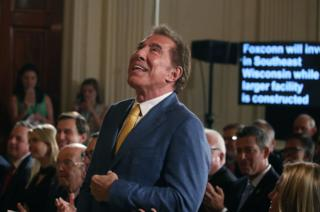 Mr Wynn, who is also a Republican official, attends an event at the White House