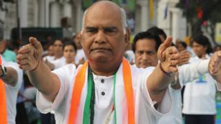 BJP presidential election candidate Ram Nath Kovind along with others perform yoga on the occasion of International Yoga Day in Delhi.