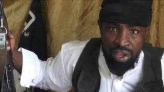 Abubakar Shekau carry gun