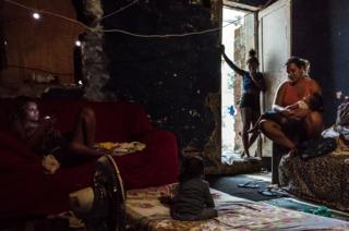 Pamela (pictured on the left) has been living at the occupied building of IBGE for the last 15 years. Pamela's mother, Martha was the second resident to move into this occupied structure. 'Favela' Mangueira community, Rio de Janeiro, Brazil.