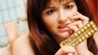 Young woman anxious about her contraception