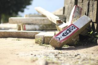 The discarded signs previously used to identify farm boundaries in the farming village of Bentum