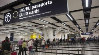People queuing up for passport control at Heathrow airport