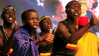 """Young people living in Uganda as refugees perform a song during refugees solidarity summit held in Uganda""""s capital Kampala June 23, 2017."""