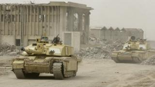 Britiash tanks on the move in the Iraqi city of Basra in 2003
