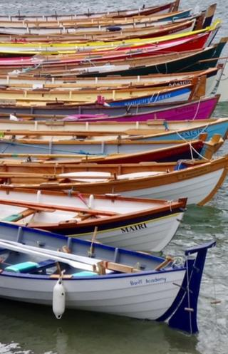 Boats lined up at the Portsoy Boat Festival
