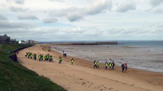 People on St Andrews beach