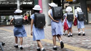 Schoolgirls walk home at Ebisu district in Tokyo on September 4, 2017.