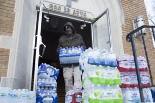 Man stacking water