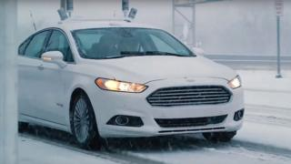 A Ford autonomous car driving in the snow