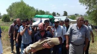 Villagers in Alkhanli bury a 2-year-old girl killed in shelling