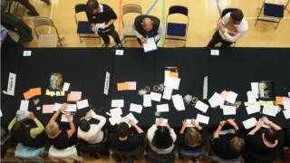 Election staff count ballot papers for the General Election, at Kendal Leisure Centre in Kendal.