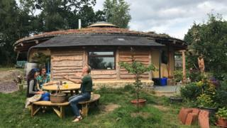 Soma, Janta, and Merav Wheelhouse at their straw bale roundhouse