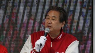 Kim Moo-sung, Chairman of the ruling Saenuri Party, speaks during a rally for the April 13 parliamentary elections in Seoul, South Korea, April 12, 2016.