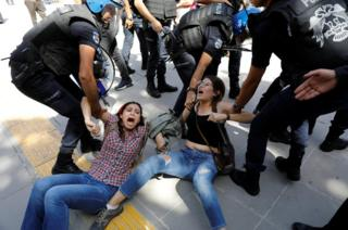 Riot police detain protesters during the trial of two Turkish teachers, who went on a hunger strike over their dismissal under a government decree following last year's failed coup, outside of a courthouse in Ankara, Turkey, 14 September 2017.