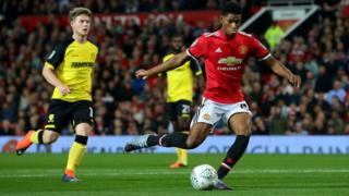 Marcus Rashford of Manchester United scores his sides first goal during the Carabao Cup Third Round match between Manchester United and Burton Albion at Old Trafford on September 20,