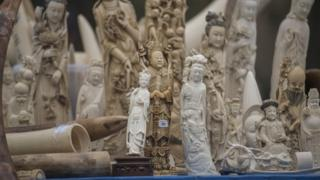 Carved ivory is shown to the media before being destroyed in Beijing on 29 May 2015