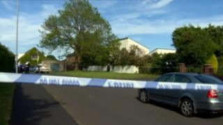 A police cordon is in place at the scene of the couple's deaths in Upper Ramone Park