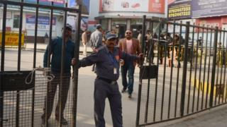 "An Indian security guard stands outside a cinema, which is not screening Bollywood film ""Padmaavat"" due to threats of violence by Hindu hardliners, in Allahabad on January 25, 2018."