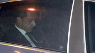 Former French President Nicolas Sarkozy leaves the Paris prosecutor's office in July 2014