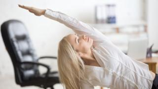 Woman doing pilates in the office