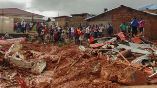 Sierra Leone residents of Freetown view damage to property due to a mudslide in the suburb of Regent behind Guma reservoir, Freetown, Sierra Leone, 14 August 2017