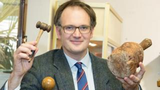Auctioneer with 4,500-year wooden maul