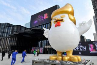 A giant rooster sculpture resembling Donald Trump outside a shopping mall in Taiyuan, Shanxi province. 24 December 2016.