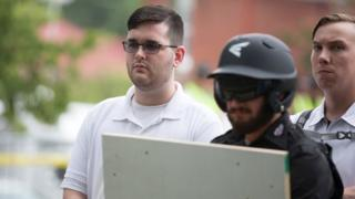 """James Alex Fields Jnr pictured at """"Unite the right"""" rally before the car attack. Standing in a white polo shirt."""