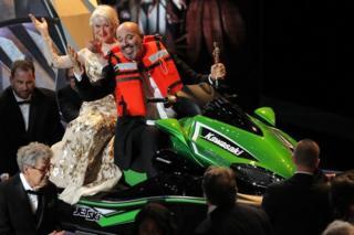 Mark Bridges and Helen Mirren riding a jet ski