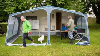 People voting in the European referendum at the polling station caravan in the village of Carlton, Cambridgeshire