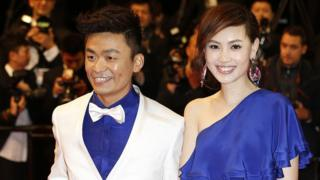Chinese actor Wang Baoqiang (L) and his wife Ma Rong pose on May 17, 2013 as they arrive for the screening of the film 'Tian Zhu Ding'