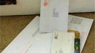 Letters being delivered through a letterbox