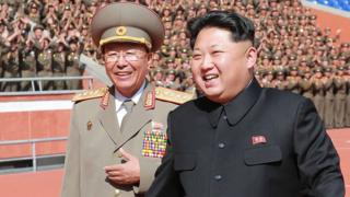 North Korean leader Kim Jong-un (R) with former chief of the Korean People's Army (KPA) General Staff Ri Yong-gil