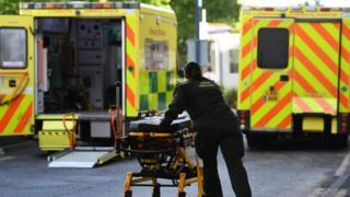 Ambulance worker pushing a trolley
