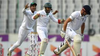 Bangladesh celebrate Cook's wicket