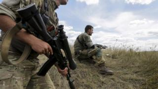 Ukrainian servicemen patrol area in Zaytseve village, near Gorlovka of Donetsk area, Ukraine, 21 August 2015