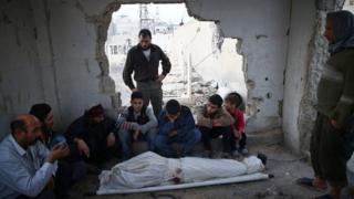 Relatives mourn 15-year-old Ziad Rihani, who was killed by shellfire in the besieged rebel-held Douma district of Damascus, Syria (14 November 2016)