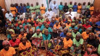 Nigeria's President Muhammadu Buhari applauds as he welcomes a group of Chibok girls, who were held captive for three years by the militant group Boko Haram, in Abuja, Nigeria, May 7, 2017