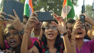 Indian students use cellphones to photograph