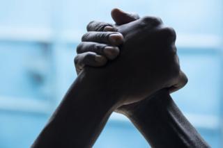 United against violence: Edward and James hold hands