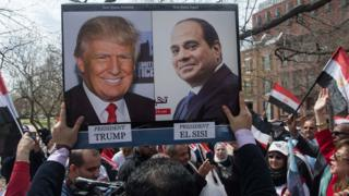 Supporters of Egyptian President Abdul Fattah al-Sisi chant slogans as he meets US President Donald Trump at the White House on 3 April 2017