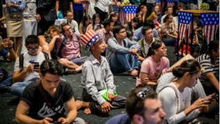 "People watch live election results hosted by the United States Consulate General at a convention center on November 9, 2016 in Ho Chi Minh City, Vietnam. Donald Trump""s stunning performance in the US presidential election triggered shock and angst in Asia, where observers fretted over the implications for everything from trade to human rights and climate change."