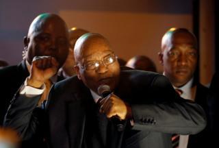 President Zuma pumps his fist in celebration