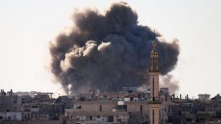 Smoke billows over a rebel-held area of Deraa, southern Syria, after a reported air strike. Photo: 19 February 2017