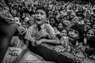 A child cries as he begs for food.