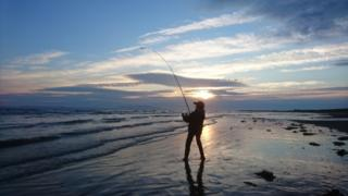 Gerry Lee's son, Ross, fishing on a beach near Troon.