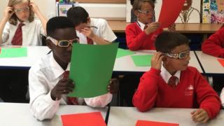 Children wearing refracting glasses